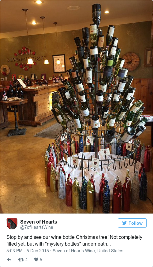 stop by and see our wine bottle christmas tree not completely filled yet but with mystery bottles underneath pictwittercomgl296sxp4r