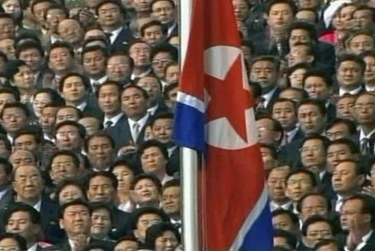 north korea flag meaning. North Korean#39;s watch the flag