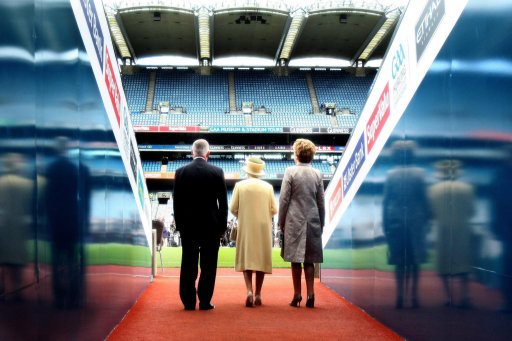 Queen Elizabeth II, President Mary McAleese and GAA President Christy Cooney walk out the tunnel towards the pitch at Croke Park. (Pic: Maxwells)