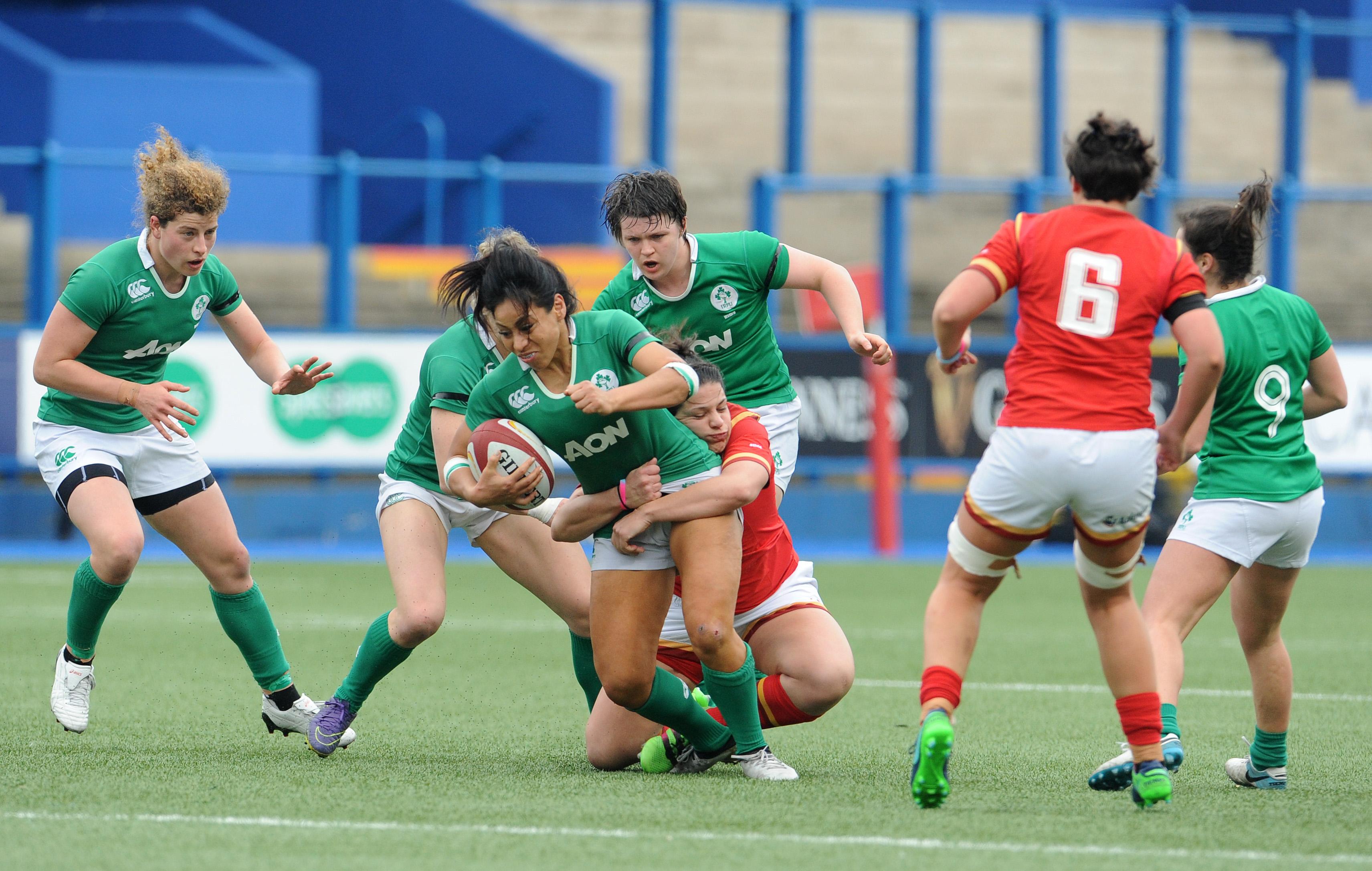 Sene Naoupu is tackled by Rebecca De Filippo